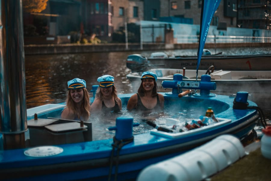 girls sat in a boat