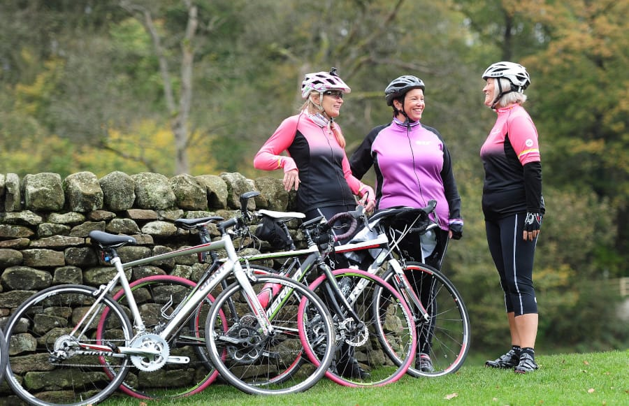 women with bikes chatting