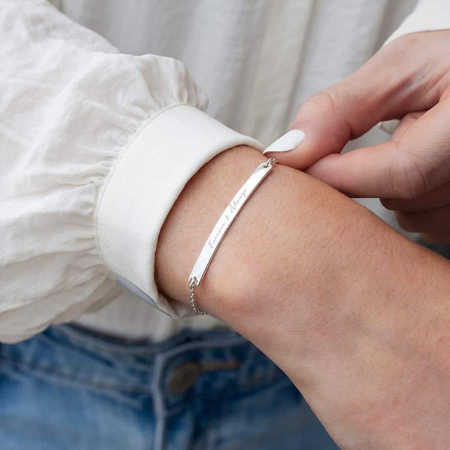 woman showing bracelet