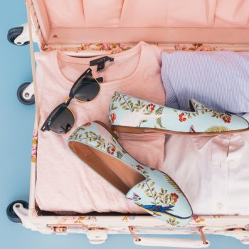 shoes and sunglasses in suitcase