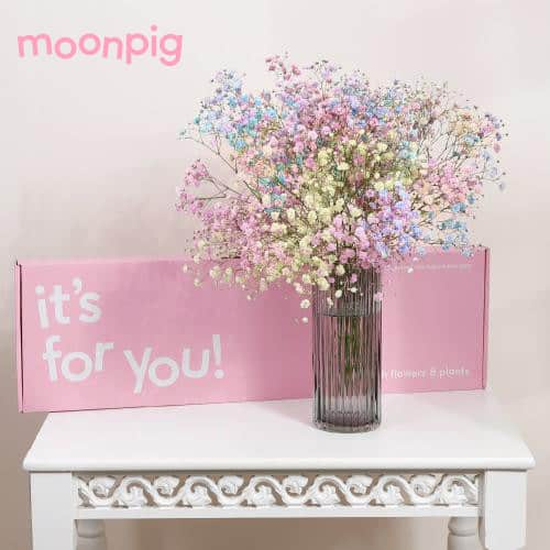 pretty flowers in a vase with box
