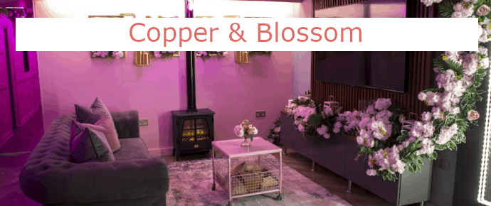hen party apartment room with flowers sofas and fireplace