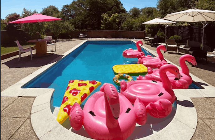 inflatable flamingos in an outdoor pool