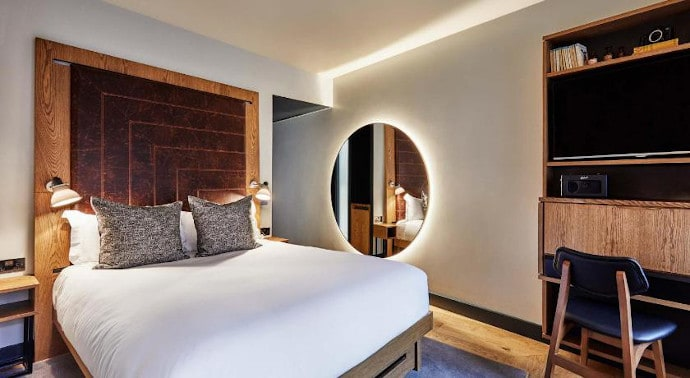 bedroom at the hoxton hotel london