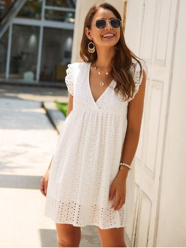 girl wearing pretty white dress smiling