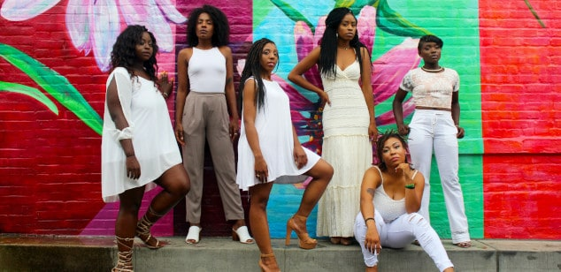 women dressed smart against colourful wall