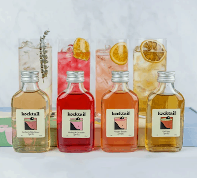 four brightly coloured bottles of drinks
